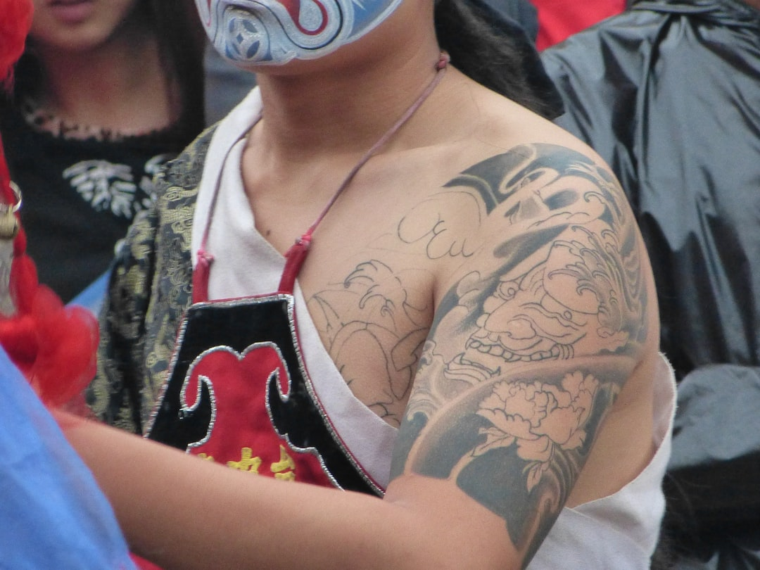 A close up of a person holding a tattoo