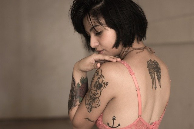 A person standing in front of a tattoo
