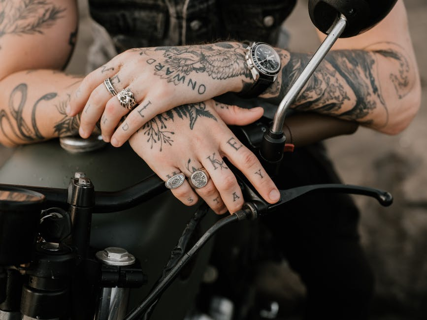 A person holding a tattoo