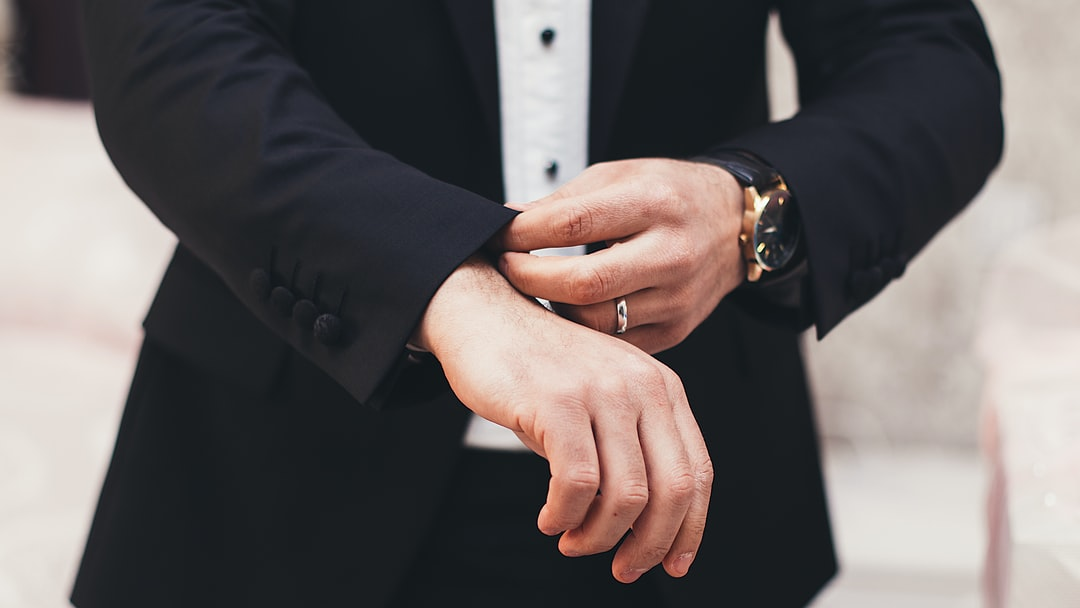 A person wearing a suit and tie